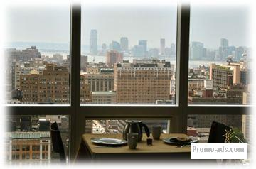 Living/Dining room facing the Hudson River and lower Manhatttan - Manhattan, New York Vacation Condo Rental